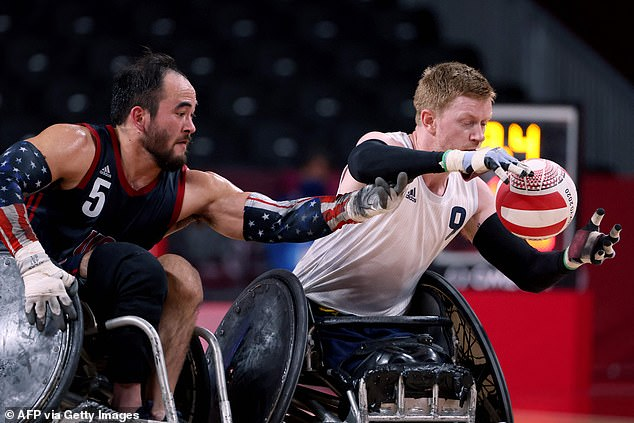 The USA'sChuck Aoki (left) battles for the ball with Jim Roberts during the gold medal match