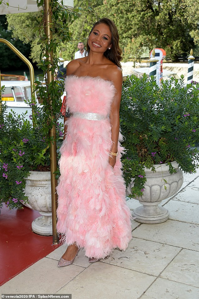 Looking good: Cinching in her waist the dress boasted a glittering belt which accentuated her statuesque figure