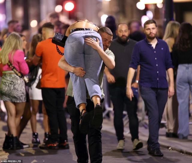One reveller is carried through the streets as hundreds in the city enjoy their three-day weekend safe in the knowledge that they will not have to go into work this morning