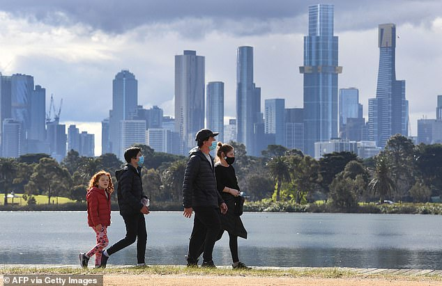 Victoria reported another 73 Covid cases on Monday with the health minister saying he said the restrictions have caused numbers to plateau (pictured: Melbourne residents on Monday)