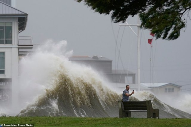 A man took pictures of high waves along the shore of Lake Pontchartrain as Hurricane Ida neared on Sunday