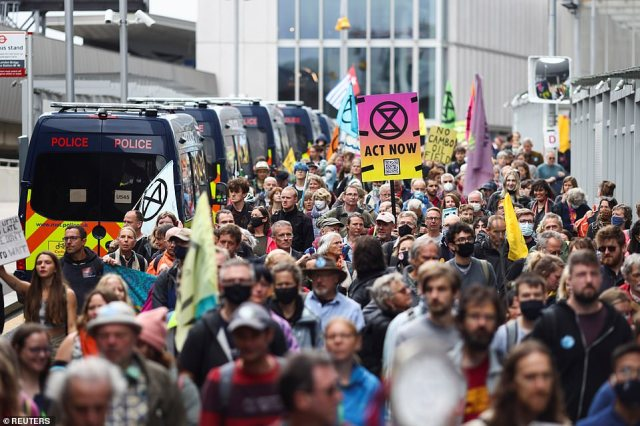 Crowds of activists massing near London Bridge today. One of the signs reads 'No Cambo oil field', referring to a new proposed site in Scotland