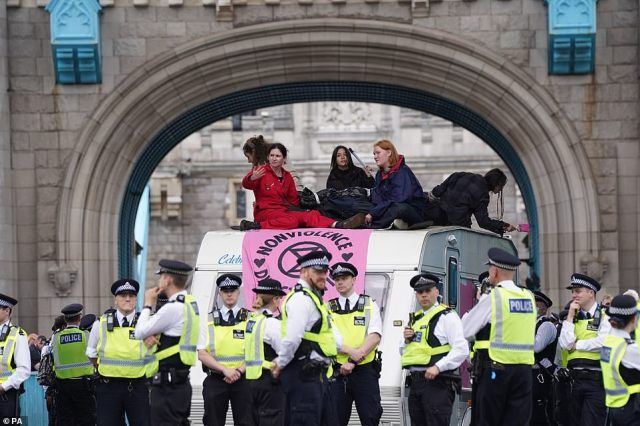 Protesters could be seen attached together on the top of a caravan under one of Tower Bridge's famous arches