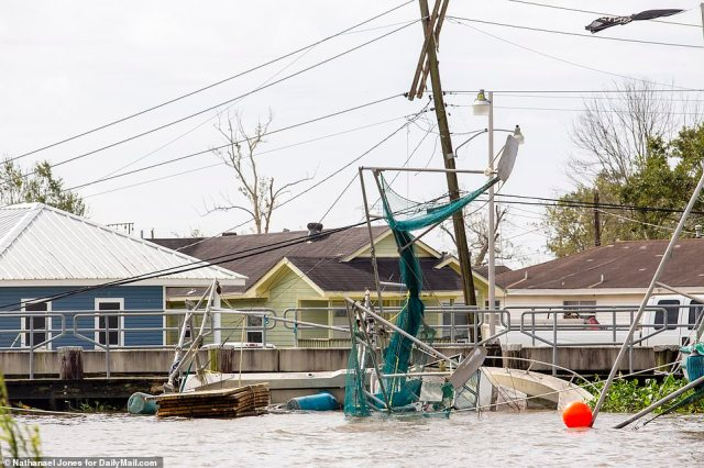 A shrimp boat in the Bayou Segnette inlet has capsized from the heavy winds of Ida in Westwego, Louisiana