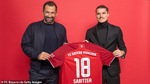 Executive board member Hasan Salihamidzic presented Sabitzer with a shirt upon his arrival