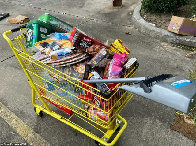Outside of the Dollar General was an abandoned shopping cart filled with goods