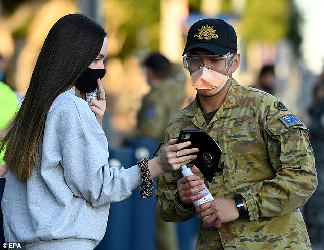 High school students have dealt with more than 18 months of intermittent lockdowns (pictured: Year 12 students at Qudos Bank Arena in Sydney line up for the Pfizer vaccine as defence force troops assist)