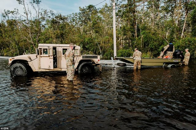 Members of the Louisiana National Guard assist in search and rescue missions related to flooding from Hurricane Ida in Jean Lafitte, Louisiana