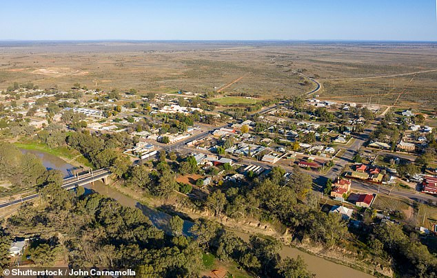 Ms Quayle said people who test positive to Covid in the outback town (pictured) are being forced to sleep in tents outside houses or by the river to isolate