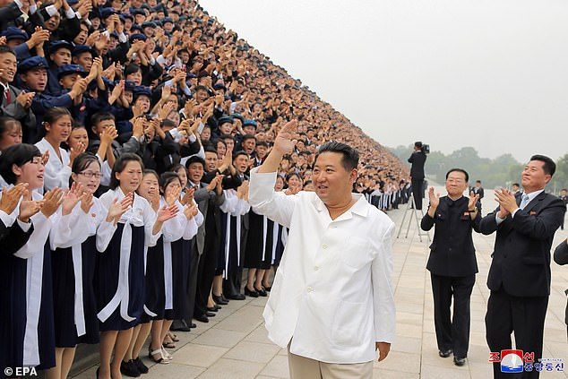 The North Korean tyrant appeared on state TV walking in front of a stand filled with hundreds of seemingly adoring school children, the girls crying and the boys clapping enthusiastically as he waved and smiled