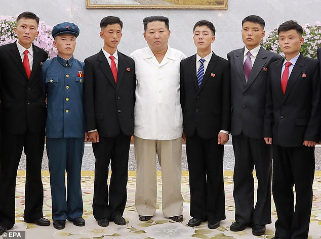 Kim Jong Un posing with youngsters this week. The photo opportunity was part of Youth Day celebrations in Pyongyang