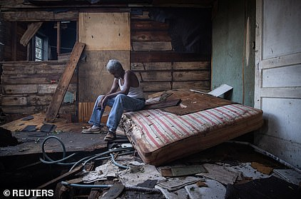'I ain't got a dry spot in the house,' Theophilus Charles (pictured) said, choking up. 'My roof fell, I lost all my clothes, my furniture, my appliances, everything.'