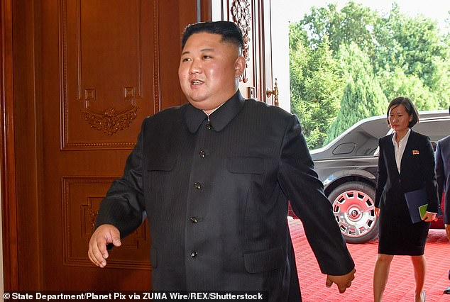 Kim Jong Un is pictured in 2018. It is believed the dicator has lost around 44 pounds