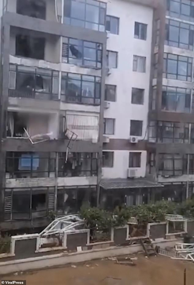 The tornado smashed windows and ripped off balconies from the apartment complex