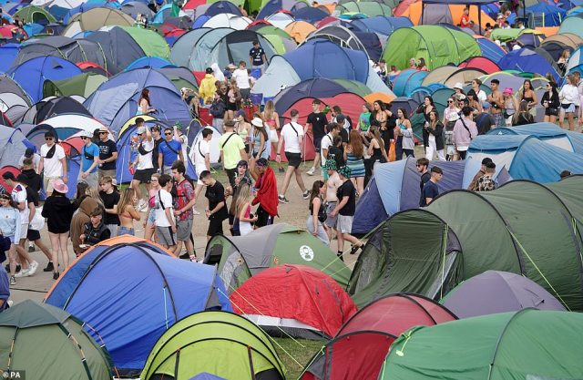 Festival goers walk past tents at the Reading Festival at Richfield Avenue.Partied-out music lovers draped themselves in duvets and slung sleeping bags over their shoulders as they left Reading Festival this morning following a weekend of fun