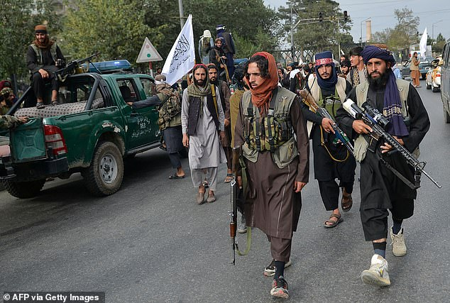 Taliban fighters gather along a street during a rally in Kabul on August 31 as they celebrate after the US pulled all its troops out of the country