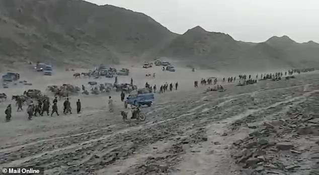 The mass migration across the desert where the borders of Afghanistan, Pakistan and Iran all meet shows an endless river of people flowing between the mountains