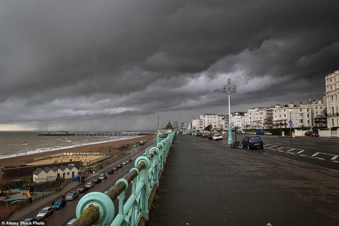 This region received only 129 hours of sunshine this month compared to its usual average of 192.5 hours, figures from the Met Office show. Pictured: Clouds loom over Brighton in East Sussex