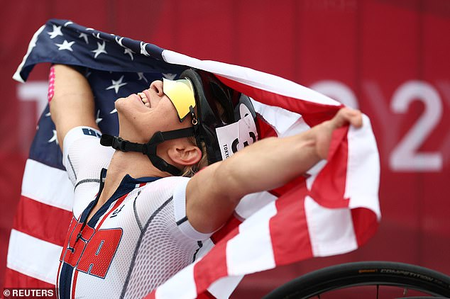 Oksana Masters held the American flag as she celebrated winning a tenth Paralympics medal