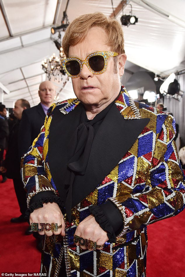 Matching: The singer said of his pal: 'He has been s******g off my boring wardrobe for years. I'm not really a fashion guy but I've had to start to show an interest – he loves it. Elton approved — it's very him.'; Elton John pictured in 2018