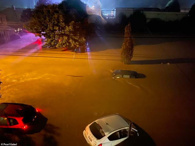 LAMBERTVILLE, NEW JERSEY: Cars are seen nearly completely submerged as the storm hit the northeast on Wednesday night