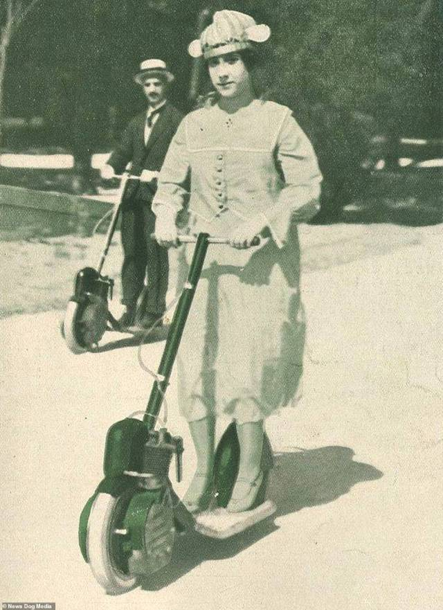 A man and woman ride two scooters in the city of Porto, Portugal, circa 1918. Many people are now calling for the controversial vehicles to be banned after accidents