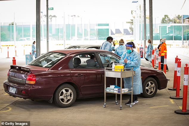 South of the border fears are rising that the current outbreak which has plunged Victoria into its sixth lockdown could be worse than first thought with cases going undetected (pictured, a drive-through vaccine centre in Melbourne)
