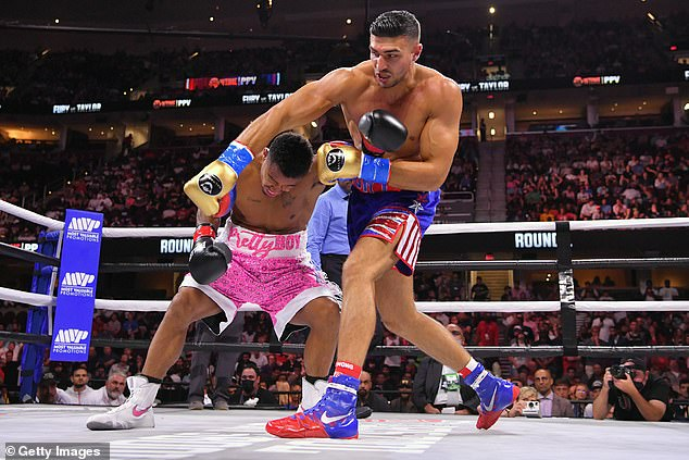 Molly's outing comes after her boyfriend and professional fighter Tommy Fury, 22, beat Anthony Taylor at a fight in Ohio on Sunday night (pictured in Cleveland)
