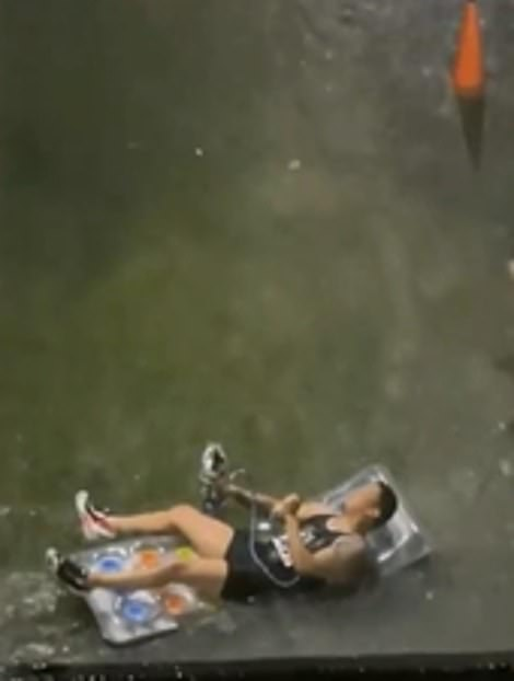 A video of a man smoking a bomb on an inflatable, dangerously riding through the storm water, last night
