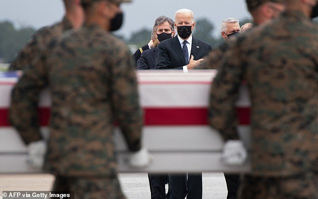 President Joe Biden's approval rating continued its downward trend since the chaotic evacuation of Afghanistan - above Biden at Dover on Sunday for the dignified transfer of the remains of fallen service members