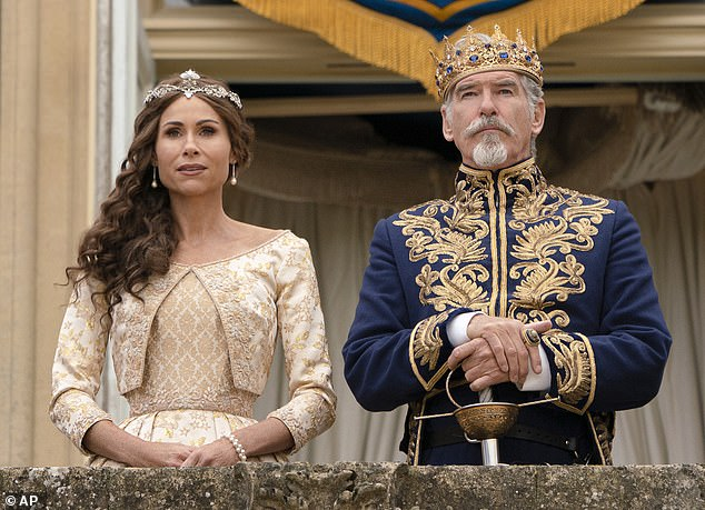 In character: Minnie is joined by Pierce Brosnan who takes on the role of King Rowan