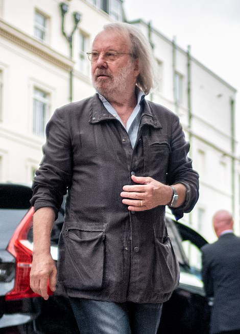 Something to look forward to? Benny Andersson seemed in good spirits as he headed out for the day