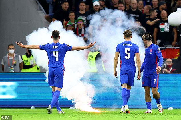 As well as abuse directed at England's stars, a flare was thrown on to the pitch during the game