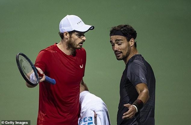 Murray (left) confronts Fabio Fognini during their Shanghai Masters clash in 2019