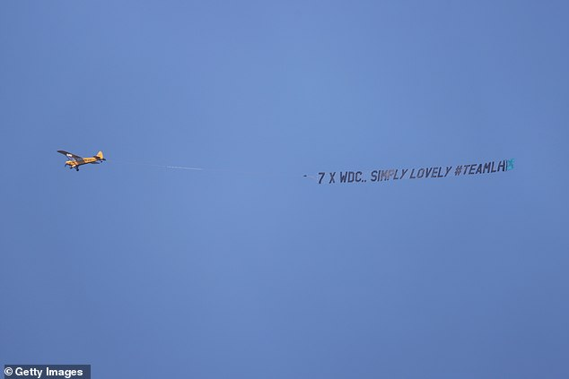 However, one fan decided to share his support for Hamilton by paying for a banner (above) to fly overhead saying '7 X WDC'