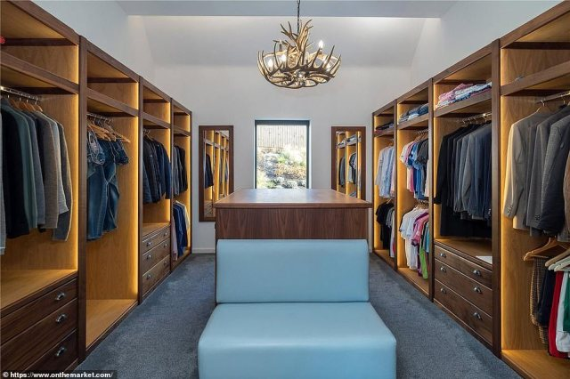 There is plenty of space for Ronaldo and Ms Rodriguez' clothes inside a large wardrobe next to the master bedroom