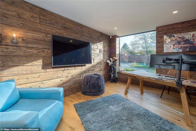 One of the rooms that is likely to be less used by the family is the office, which again features a large window to allow in plenty of light, as well as a TV and desk