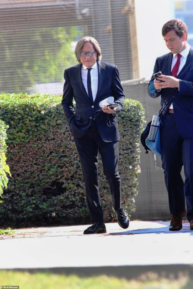 He continued: 'My gratitude to my team ... a great win for the defense. And the jury that understood the right from wrong.' Above, Hadid walks out of the Santa Monica courthouse on Monday, August 30