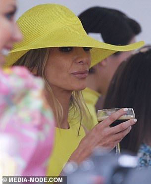 Still on the scene: A few months later in November, Nadia made it clear the split was not to be the end of her social life attending Melbourne's star studded spring racing carnival