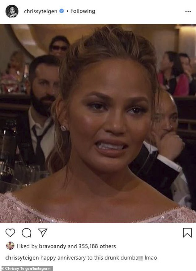Memorable moment: Teigen also shared a photo of herself crying at the Golden Globes several years back as she wished 'this drunk dumb***' a happy anniversary