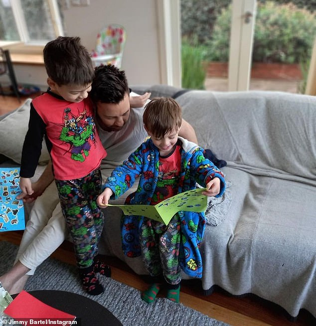 Celebration: The former Australian rules footballer shared a series of photos alongside his two sons to Instagram as they gave him gifts