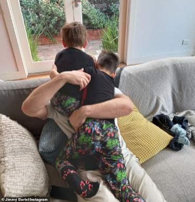 Family: In one image, Aston and Henley hugged their father as he sat on a lounge