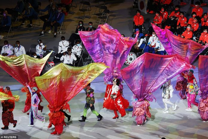 Entertainers delighted viewers with their colourful and quirky clothes while the athletes watched on