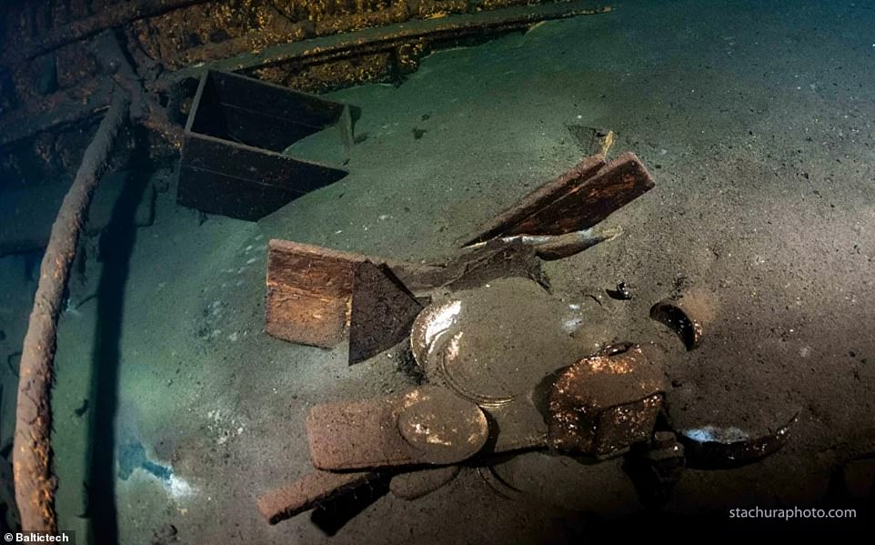 Artefacts buried underneath sand inside the ship at the bottom of the Baltic Sea