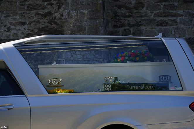 The cortege leaves the Church of St Andrews today following the funeral today for two of the Plymouth massacre victims