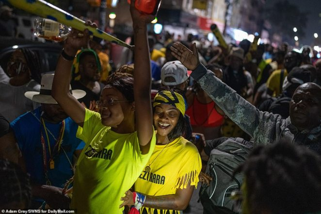 Hundreds of revelers danced and partied in the early morning hours of Labor Day - unbothered by the city's decision to cancel the official celebration