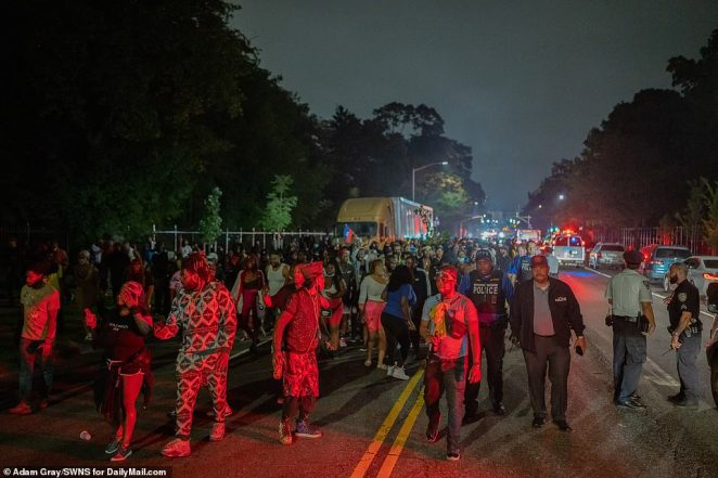 Hundreds of revelers walked along Eastern Parkway near the Prospect Park section of Brooklyn early on Monday morning
