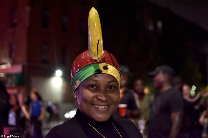 The image above shows a woman at the J'Ouvert festivities at the intersection of East 53rd Street and Clarkson Avenue in Brooklyn on Monday