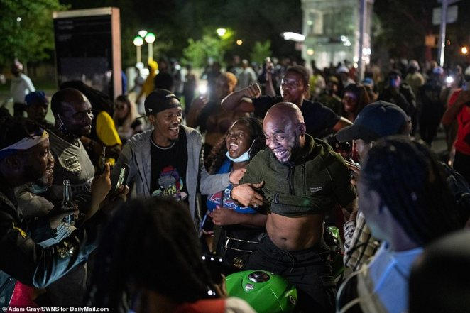 Partygoers enjoy the unofficial J'Ouvert festivities in Brooklyn before dawn on Monday