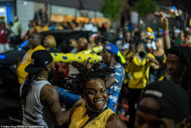 Partygoers enjoy themselves at the unofficial J'Ouvert celebrations in the Prospect Park section of Brooklyn on Monday